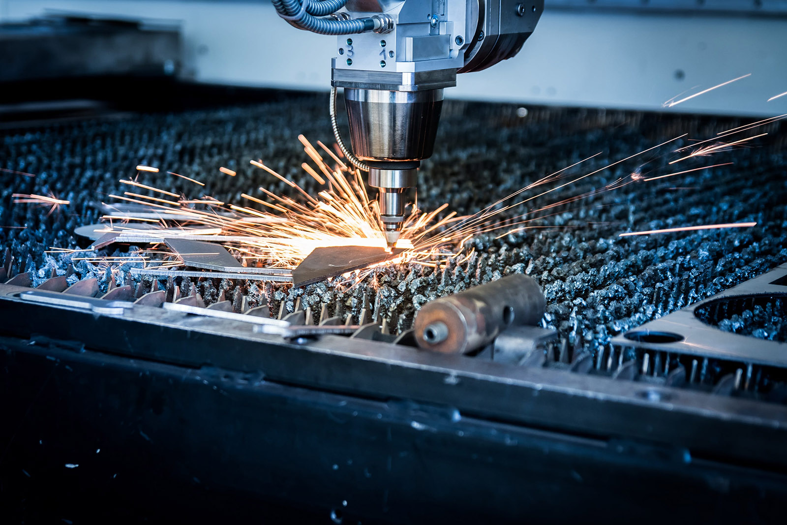 Robotic Arm Welding a Part in Production